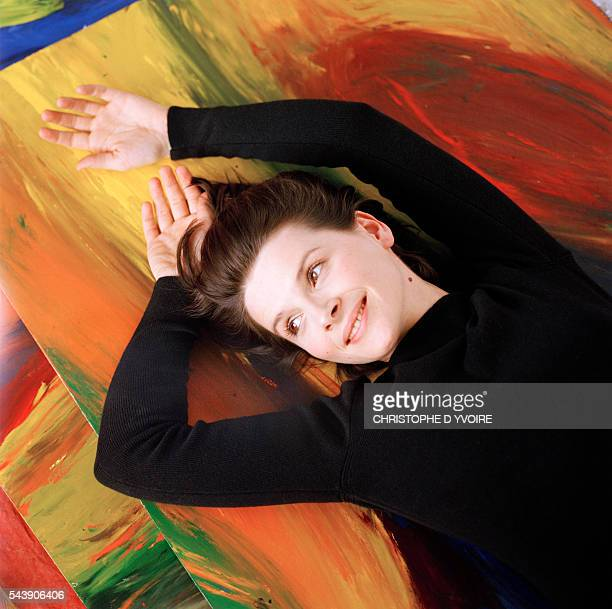 Juliette Binoche with paintings of her own creation