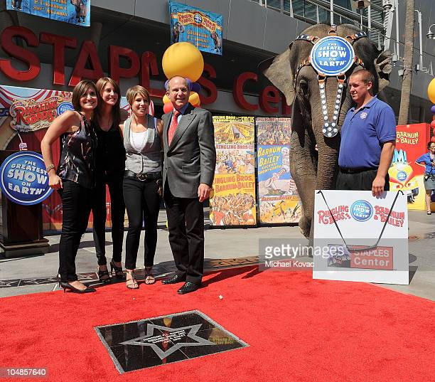 Juliette Feld, Alana Feld, Nicole Feld, and Feld Entertainment CEO Kenneth Feld are accompanied by KellyAnne the Elephant and her trainer at the star...