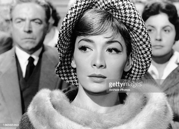 Juliette Greco looking behind her in a scene from the film 'Crack In The Mirror' 1960