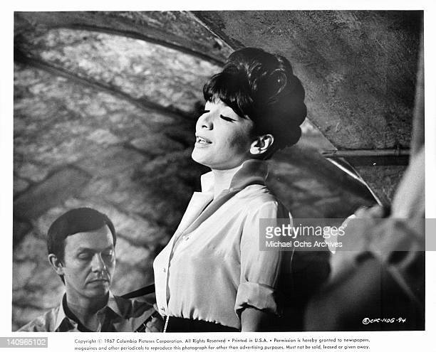 Juliette Greco standing with her eyes closed in a scene from the film 'Night Of The Generals' 1966