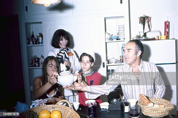 Juliette GRECO with his daughter Laurence , and Michel Piccoli and his daughter Cordelia take tea in the kitchen of their large house Verderonne,...