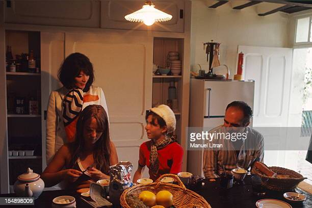 Juliette GRECO with his daughter Laurence and Michel Piccoli and his daughter Cordelia take tea in the kitchen of their large house Verderonne near...