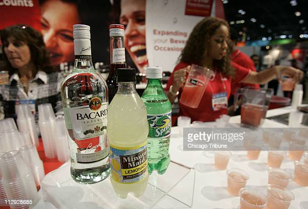 Juliette Hagerman pours samples of a Bacardi Pomegranate Punch at a food show in Chicago Illinois on May 22 2006