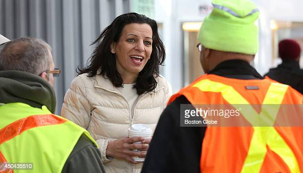 Juliette Kayyem Democratic candidate for governor chats with workers at the Forest Hills T station on Thursday March 27 2014