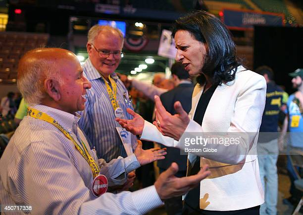 Juliette Kayyem greets delegate Bil Bilwakesh from Andover Mass at the Democrat State Convention at the DCU Center in Worcester Mass