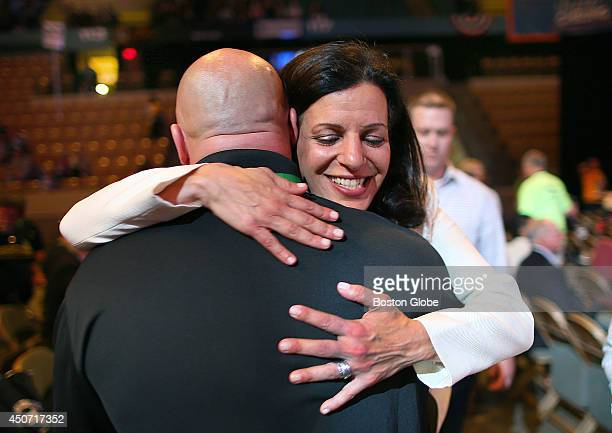 Juliette Kayyem hugs a delegate on the floor of the Democrat State Convention at the DCU Center in Worcester Mass