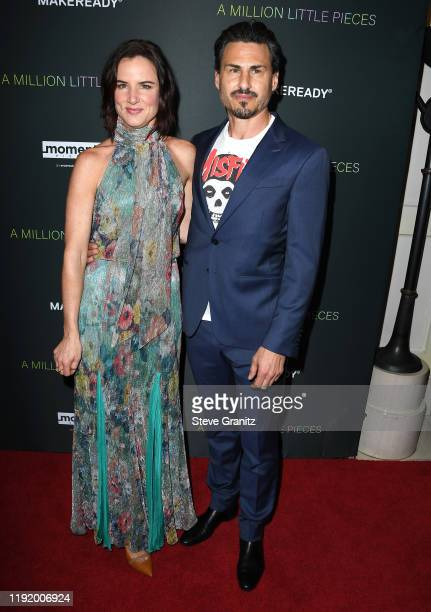 """Juliette Lewis and Brad Wilk arrives at the """"A Million Little Pieces"""" at The London Hotel on December 04, 2019 in West Hollywood, California."""