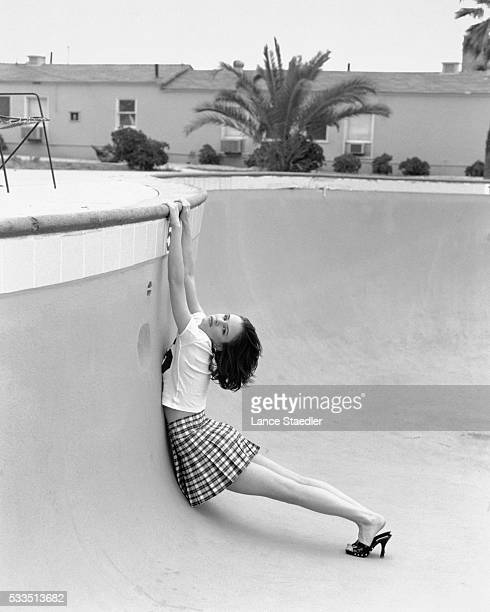 Juliette Lewis Hanging from Swimming Pool Edge