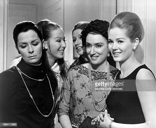 Juliette Mayniel is entertaining a group of her friends including Beba Loncar in a scene from the film 'Listen Let's Make Love' 1968