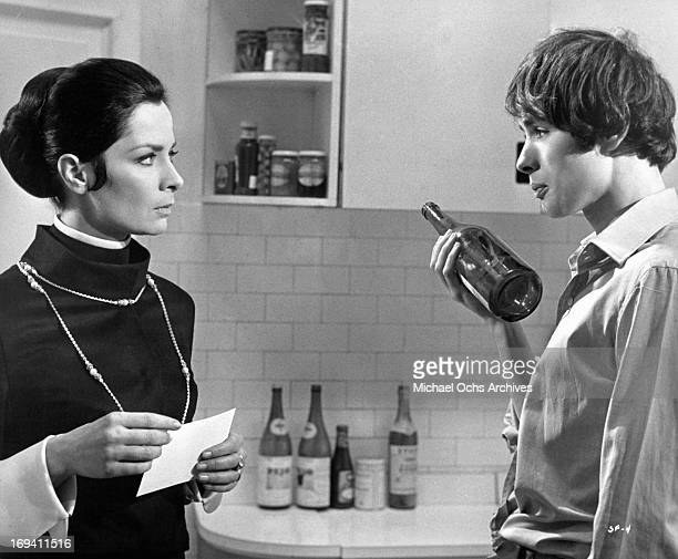 Juliette Mayniel reproaches Pierre Clementi for taking the last cold drink in the refrigerator in a scene from the film 'Listen Let's Make Love' 1968