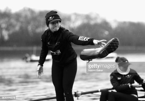 Juliette Perry of Oxfords 'Coursing River' throws her Hunter boot to the shore prior to The Cancer Research UK Boat Race Trial 8s on January 21 2018...