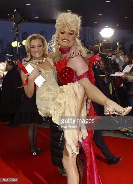 Juliette Schoppmann gets a lift from tansvestite Olivia Jones