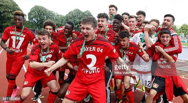 Julijan Popovic of Leverkusen and teammates celebrate the win of the cup after the U17 German Championship Final match between Borussia Dortmund U17...