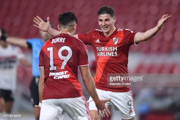 Julián Álvarez of River Plate celebrates with teammate Rafael Santos Borré after scoring the second goal of his team during a Copa CONMEBOL...