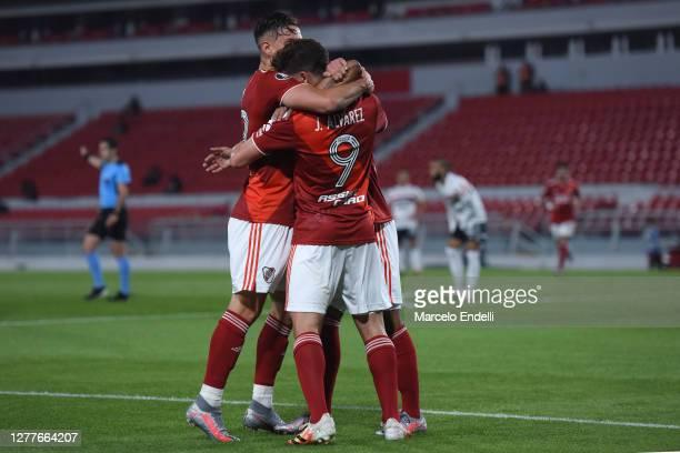 Julián Álvarez of River Plate celebrates with teammates Rafael Santos Borré and Nicolás De La Cruz after scoring the first goal of his team during a...