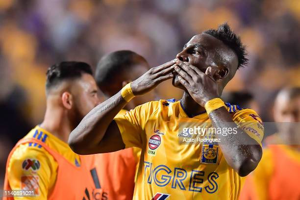 Julián Quiñones of Tigres celebrates after scoring his team's second goal during the 23th round match between Tigres UANL and Pumas UNAM as part of...