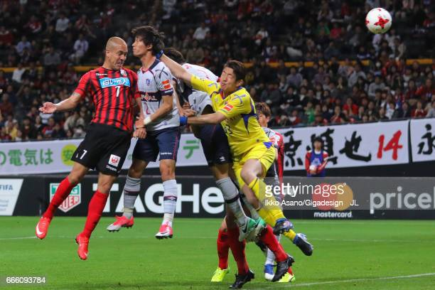 Julinho of Consadole Sapporo heads the ball to score his side's first goal during the J.League J1 match between Consadole Sapporo and FC Tokyo at...