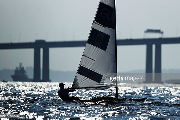 Julio Alsogaray of Argentina competes in the Men's Laser class races on Day 4 of the Rio 2016 Olympic Games at the Marina da Gloria on August 9 2016...