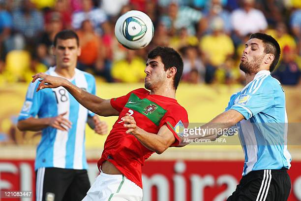 Julio Alves of Portugal is challenged by Matias Laba of Argentina during the FIFA U20 World Cup 2011 quarter final match between Portugal and...