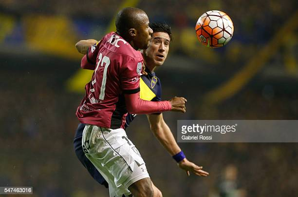 Julio Angulo of Independiente del Valle jumps for the ball with Pablo Javier Perez of Boca Juniors during a second leg match between Boca Juniors and...