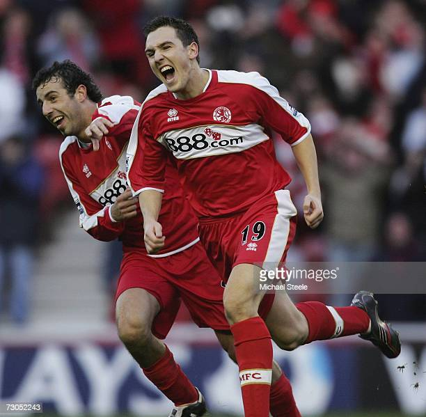 Julio Arca celebrates with Stewart Downing scorer of the fourth Middlesbrough goal during the Barclays Premiership match between Middlesbrough and...
