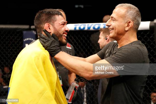 Julio Arce celebrates after his knockout victory over Julian Erosa in their featherweight bout during the UFC Fight Night event at Blue Cross Arena...