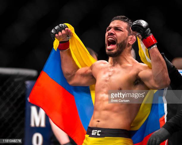 Julio Arce celebrates his victory against Julian Erosa after a featherweight bout at Blue Cross Arena on May 18, 2019 in Rochester, New York. Arce...