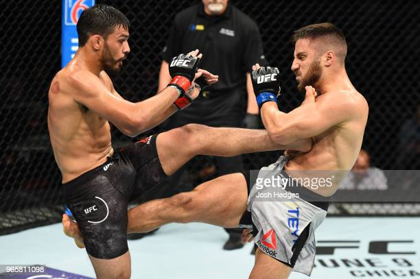 Julio Arce kicks Daniel Teymur of Sweden in their featherweight fight during the UFC Fight Night event at the Adirondack Bank Center on June 1 2018...