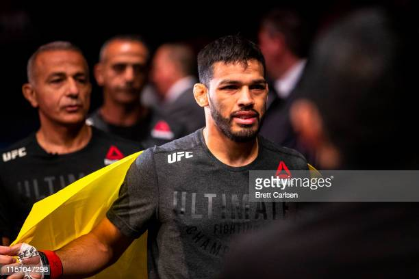 Julio Arce makes his way to the ring for a featherweight bout against Julian Erosa at Blue Cross Arena on May 18, 2019 in Rochester, New York. Arce...