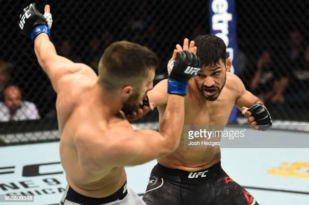Julio Arce punches Daniel Teymur of Sweden in their featherweight fight during the UFC Fight Night event at the Adirondack Bank Center on June 1 2018...