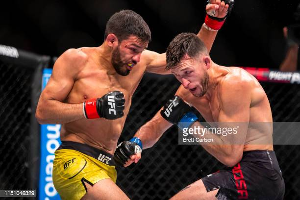 Julio Arce trades blows with Julian Erosa during round three of a featherweight bout at Blue Cross Arena on May 18, 2019 in Rochester, New York. Arce...