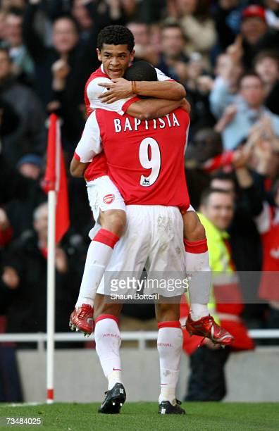 Julio Baptista of Arsenal celebrates with team mate Denilson after scoring his sides second goal during the Barclays Premiership match between...
