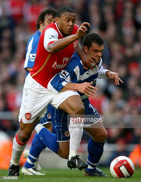 Julio Baptista of Arsenal hold off the challenge of Graeme Murty of Reading to score his sides second goal during the Barclays Premiership match...