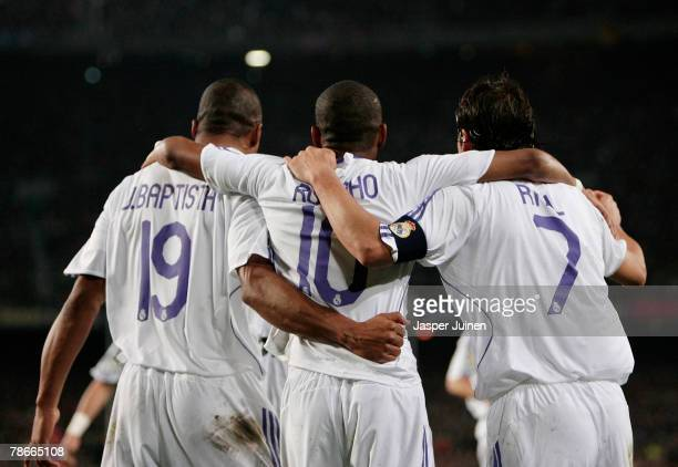 Julio Baptista of Real Madrid walks away after celebrating his opening goal with his teammates Raul Gonzalez and Robinho during the La Liga match...
