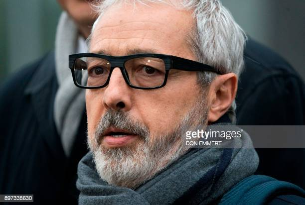 Julio Barbosa attorney for Jose Maria Marin of Brazil one of three defendants in the FIFA scandal talks to the media as he departs the Federal...