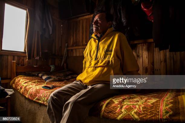 Julio Bautista displaced by the violence in GaitanaTolima sits on a couch in his house in Bogota Colombia on November 27 2017 Bautista said 'I'm more...
