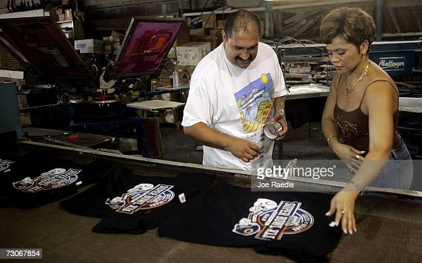 Julio Berrio and Christina Ramos work on printing Super Bowl XLI teeshirts at 1 Stop Promo's January 22 2007 in Miami Florida Local business's are...