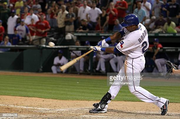 Julio Borbon of the Texas Rangers drives in a run on a single against the Oakland Athletics in the 11th inning on May 11, 2010 at Rangers Ballpark in...
