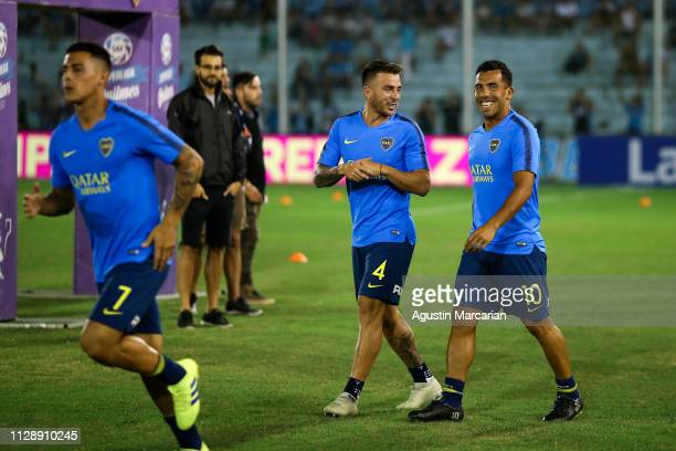 Julio Buffarini and Carlos Tevez of Boca Juniors laugh during the warm up before a match between Belgrano and Boca Juniors as part of Superliga...