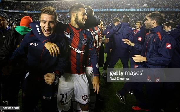Julio Buffarini and Emmanuel Mas of San Lorenzo celebrate advancing to the final after a second leg semifinal match between Bolivar and San Lorenzo...