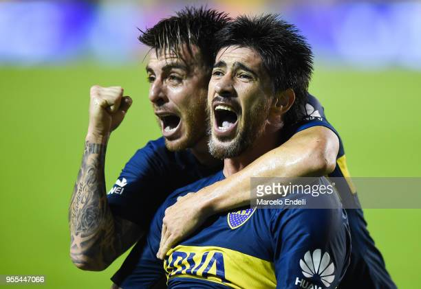 Julio Buffarini and Pablo Perez of Boca Juniors celebrates after teammate Ramon Abila scored the first goal of his team during a match between Boca...
