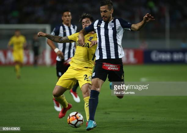 Julio Buffarini Boca Juniors struggles for the ball with Tomas Costa of Alianza Lima during a groups stage match between Alianza Lima and Boca...