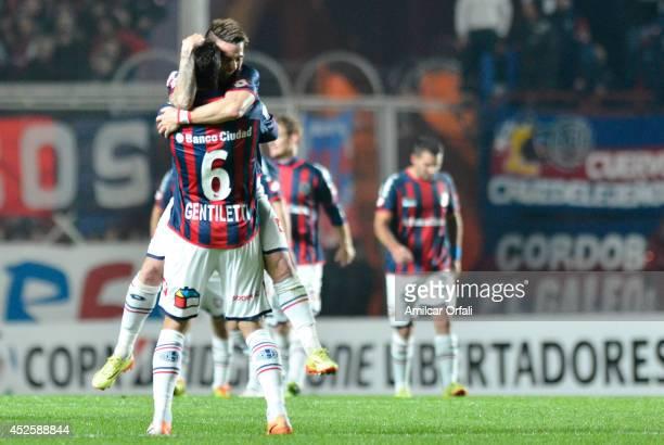 Julio Buffarini celebrates his goal with Santiago Gentiletti of San Lorenzo during a first leg semifinal match between San Lorenzo and Bolivar as...