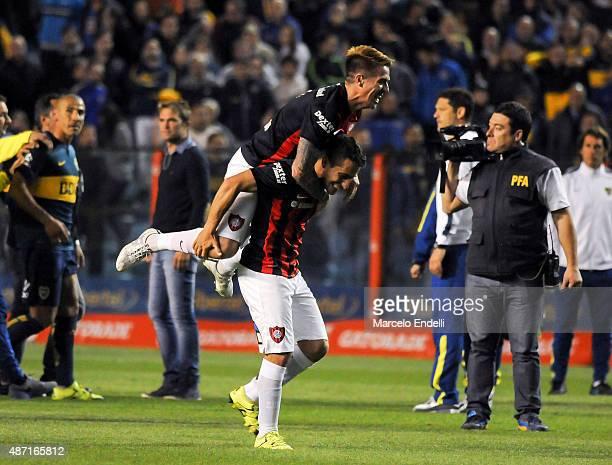 Julio Buffarini celebrates with Sebastian Blanco after winning a match between Boca Juniors and San Lorenzo as part of 23rd round of Torneo Primera...