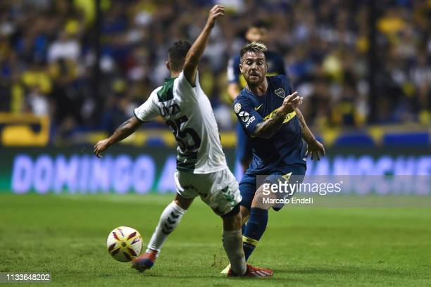 Julio Buffarini of Boca Juniors fights for the ball with Agustin Urzi of Banfield during a match between Boca Juniors and Banfield as part of...