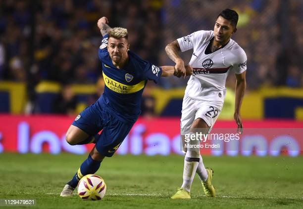 Julio Buffarini of Boca Juniors fights for the ball with Gabriel Rojas of San Lorenzo during a match between Boca Juniors and San Lorenzo as part of...