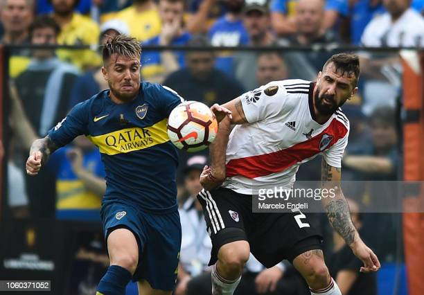 Julio Buffarini of Boca Juniors fights for the ball with Lucas Pratto of River Plate during the first leg match between Boca Juniors and River Plate...