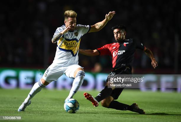 Julio Buffarini of Boca Juniors fights for the ball with Marcelo Estigarrabia of Colon during a match between Colon and Boca Juniors as part of...