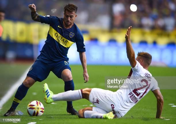 Julio Buffarini of Boca Juniors fights for the ball with Nicolas Pasquini of Lanus during a match between Boca Juniors and Lanus as part of Superliga...