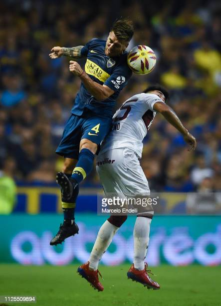 Julio Buffarini of Boca Juniors heads the ball during a match between Boca Juniors and Lanus as part of Superliga 2018/19 at Estadio Alberto J...